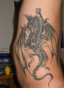 My second tattoo, a silver dragon running up my left side